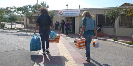 Volunteers bringing medicines to the clinic. Photo from the BBC.
